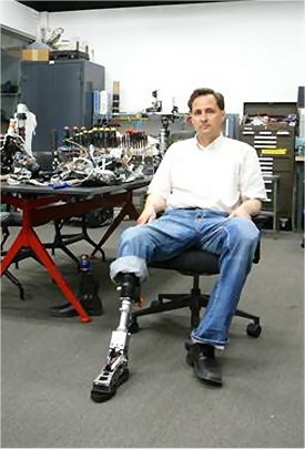 HUgh Herr, MIT researcher and double amputee, shows off one of his prosthetic legs.