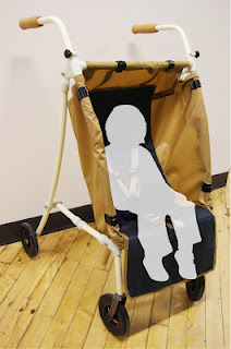 The Mainframe with fabric draped over its structure, as a proposed stroller adaptation