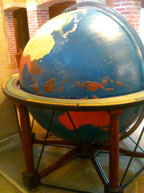 The large-scale haptic globe, with its bumpy mountain ranges and earth formations. It's the size of a small car.