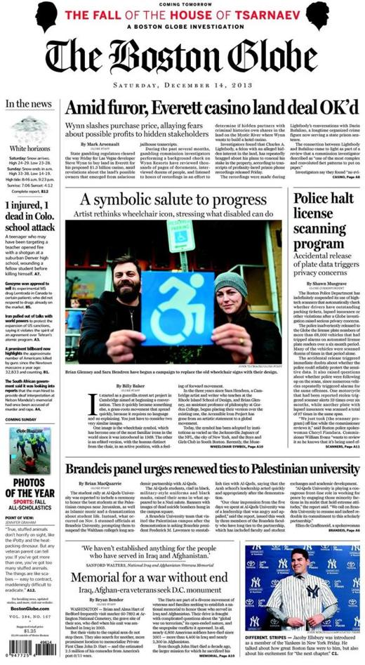 "a shot of the front page of the Globe, featuring a story titled ""A symbolic salute to progress."" Brian Glenney, my design partner, and I are holding one of our newest stickers in front of a standard ISA on a parking sign."