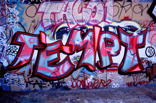 "A graffitied wall reaing ""Tempt""in pinks, reds, and blues— the name of the graffiti artist who is the subject of the film."