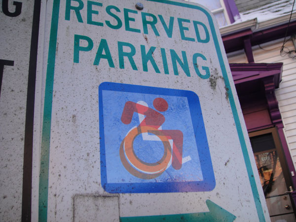 Alber handicap symbol on a parking sign