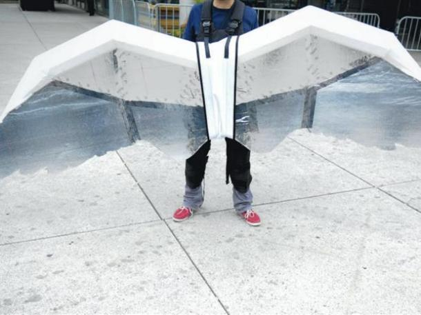 a man wears a flight suit made of white wings of about a 6 foot span, part of Jeremijenko's collaborative project with Usman Haque, to create personal flight paths as future transportation.