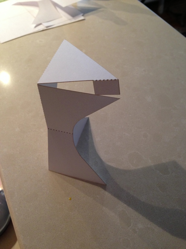 a tiny laser-cut paper model for a lectern. We used its folds to imagine how the piece would fit together without hardware.