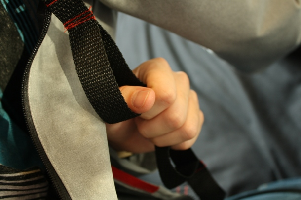 A close-up of Ryan's zipper with tether pull, so his thumb can easily reach through and unzip it.