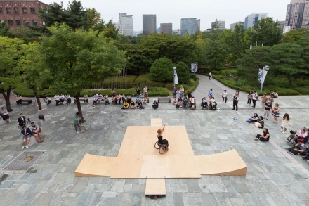 Alice dances on six tiles and four ramps at the opening of Media City Seoul. The platform kit is a wooden modular stage for ramped dancing.